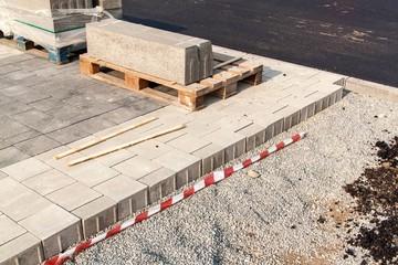 New pavement. Installing of concrete brick pavement to gravel foundation.