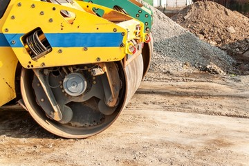 Road roller working at road construction site. Detailed view of a road roller. Construction work.