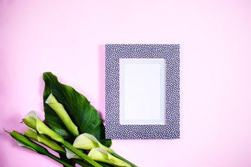 Modern blank frame top view calla flowers
