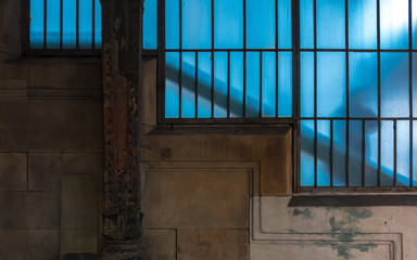 a person behind a blue old window