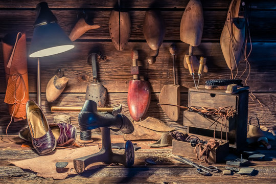 Closeup of cobbler workshop with tools, leather and shoes