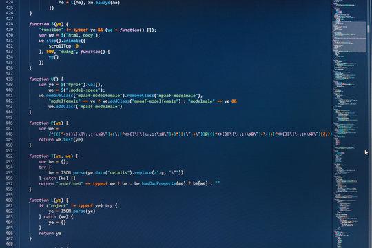 Website design. Screen of web developing javascript code. Displaying program code on computer. WWW software development. Mobile app building. Programming code abstract screen of software developer.