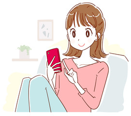 A young woman is relaxing indoors while using a smartphone