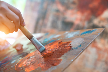 Closeup of brush and palette. Wall mural