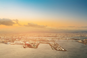 Aerial view Osaka city port skyline sunset tone, Japan cityscape background