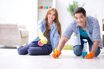 Young family cleaning the house