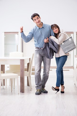 Married couple in the shop choosing furniture