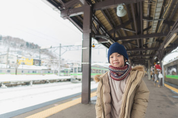 Cute asian child at railway station