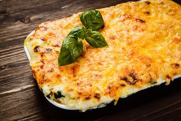 Lasagna on wooden table