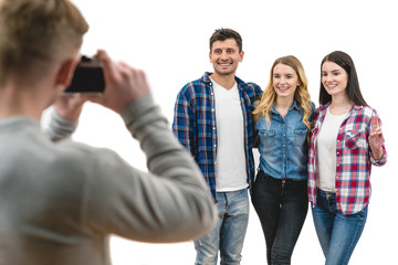 The four happy people make a photo on the white background