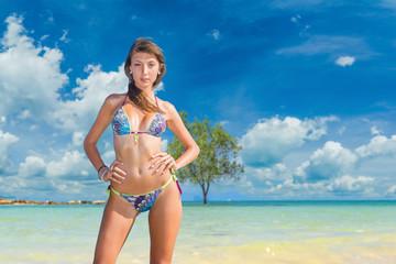Woman on vacation. Beautiful girl on beach.