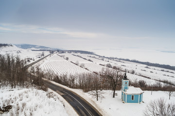 small blue chapel with snow
