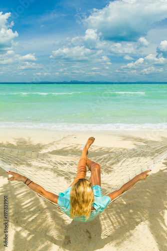 woman relaxing at the beach stock photo and royalty free images on