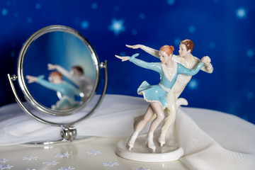 Figure skaters with reflection in a mirror
