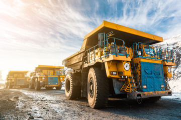 Large quarry dump truck. Loading the rock in dumper. Loading coal into body truck. Production useful minerals. Mining truck mining machinery, to transport coal from open-pit as the Coal Production.
