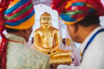 A monastery altar with deities of Padmasambhava, Buddha and Mait