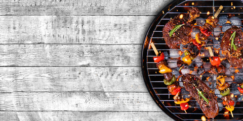 Photo on textile frame Grill / Barbecue Top view of fresh meat and vegetable on grill placed on wood