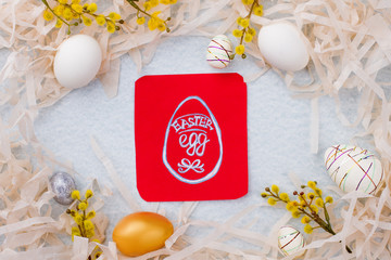 Easter festive background with eggs. Creative Easter frame and picture of Easter egg on red card. Easter common attribute.
