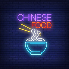 Chinese food neon sign. Bowl of noodles with chopsticks on brick wall background. Night bright advertisement. Vector illustration in neon style for street food and restaurant