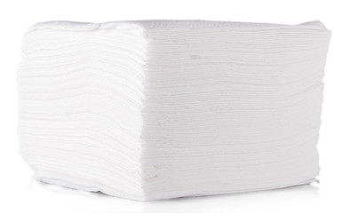 Stack of folded disposable paper tissues on white background.