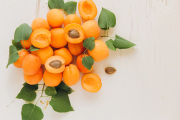 Pile of whole and cut apricots