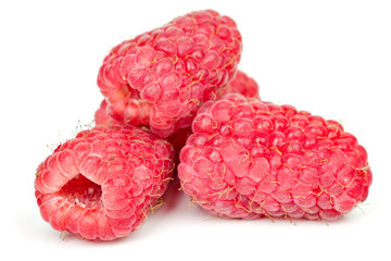 ripe juicy raspberries on white table