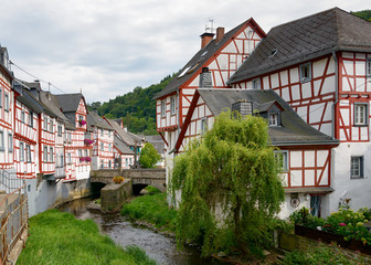 Village Monreal with half timbered houses along creek Eltzbach in the Eifel, Rhineland-Palatinate, Germany