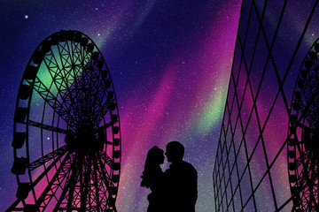 Lovers in amusement park at night. Vector illustration with silhouette of loving couple and Ferris wheel. Northern lights in starry sky