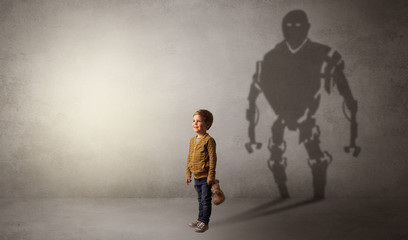 Little boys self image appear as a big robotman shadow on his background