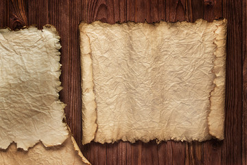 Ancient paper, scrolls on a wooden table as background