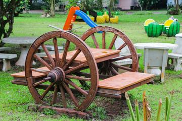 Ox cart wheel seat at tropical garden