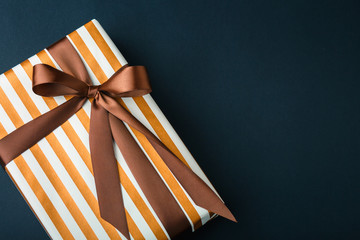gift on a dark background, top view on a gift box