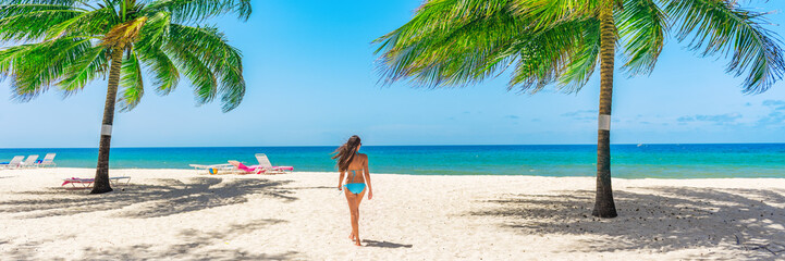 Wall Mural - Barbados beach woman walking relaxing under the sun in swimsuit happy on Dover beach, Caribbean island, Cruise travel destination. Banner panorama.