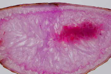 Pink agate .Stone agate texture  close-up. Natural stone agate background.Background With Slice Of Natural Stone Agate