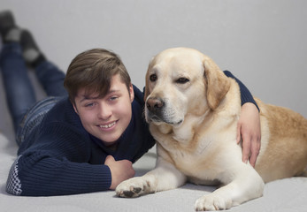teenager boy and yellow labrador