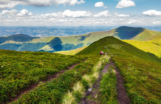 footpath through Borzhava mountain ridge in summer. group of tourists following the path. lovely landscape and travel concept