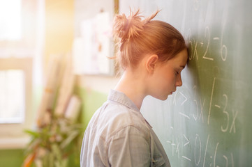 Teenager girl in math class overwhelmed by the math formula. Pressure, Education, Success concept. Wall mural