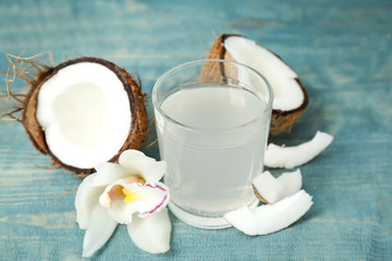 Glass of coconut water on wooden table