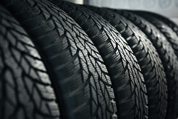 Car tires in automobile service center, closeup