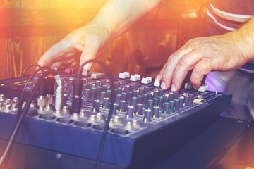 DJ's hands on turntable