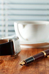 Pen, coffee and clock