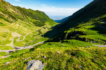 transfagarasan road in mountains of Romania. gorgeous view of the landscape from the edge of a hill. serpentine road with is winding down the valley