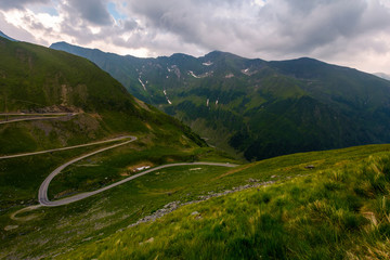 serpentine of Transfagaras down the hill. lovely transportation scenery on a cloudy day