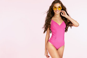 Women Style. Happy Woman In Sunglasses And Swimsuit.