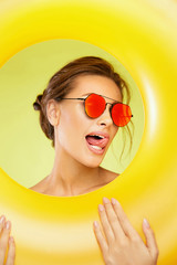 Summer Fun. Beautiful Woman Wearing Sunglasses.