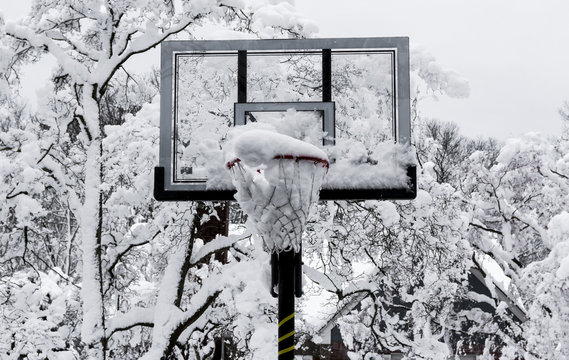 Basketball hoop with snow in it after a storm