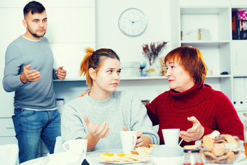 Mother comforting daughter after discord with husband