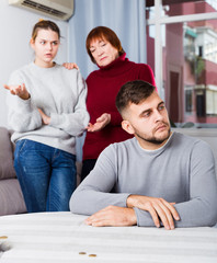 Chagrined guy having problems in relationship with family