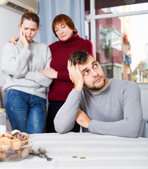 Upset man having problems in relationship with family