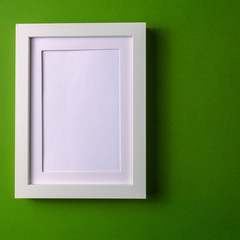 Abstract minimalism colofrul paper background with empty picture frame. and copy space.